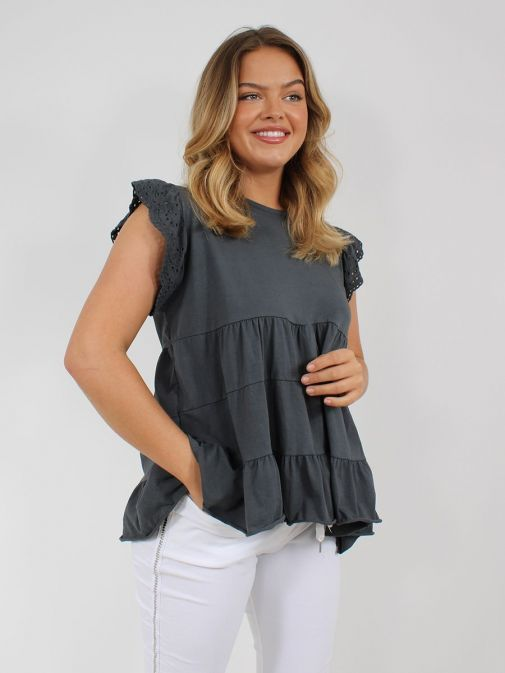 Front shot of the Cilento Women Ruffle Detail Top in the Grey featuring cap sleeves with Broderie Anglaise detailing, rounded neckline and ruffle detailing to the bottom of the top