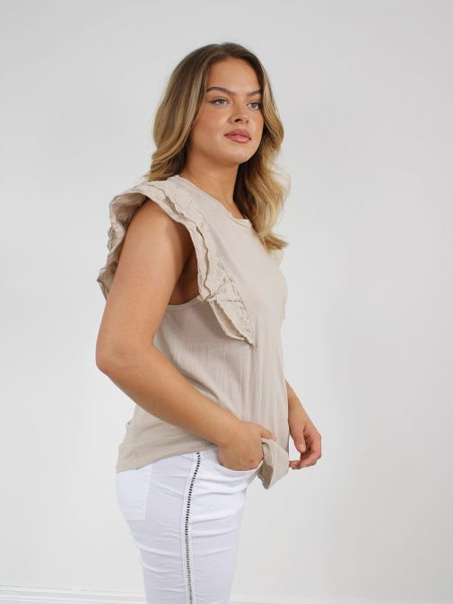 side shot of the Cilento Woman Broderie Butterfly Frill Sleeve Top in the Beige colour featuring a rounded neckline, frill sleeves with broderie pattern
