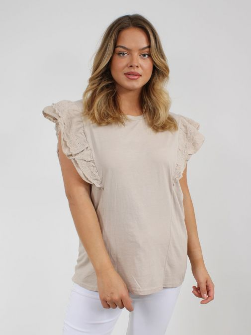 Front shot of the Cilento Woman Broderie Butterfly Frill Sleeve Top in the Beige colour featuring a rounded neckline, frill sleeves with broderie pattern