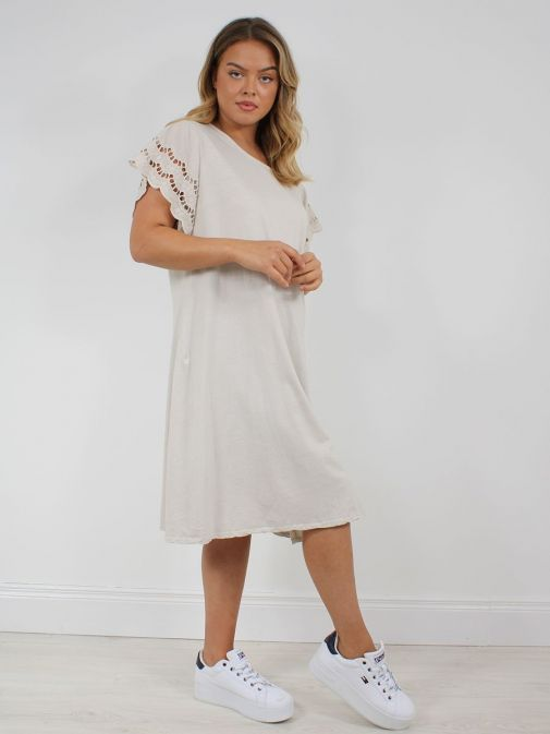 Front shot of the Cilento Woman Broderie Butterfly Sleeve Dress in the Beige colour featuring broderie short sleeves, rounded neckline and a midi length