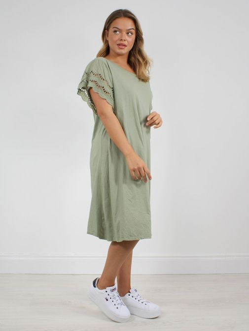 side shot of the Cilento Woman Broderie Butterfly Sleeve Dress in the green colour featuring broderie short sleeves, rounded neckline and a midi length