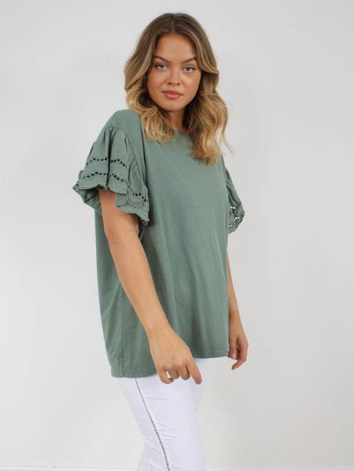Model wearing Cilento Woman Broderie Butterfly Sleeve Top in Khaki Green