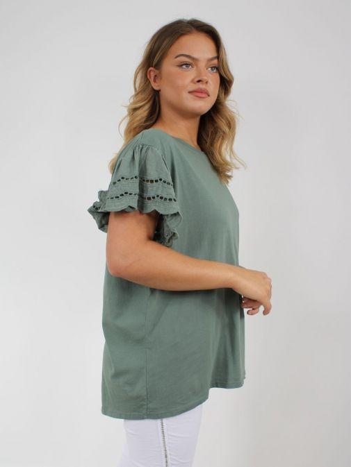 Side shot of model wearing Cilento Woman Broderie Butterfly Sleeve Top in Khaki Green