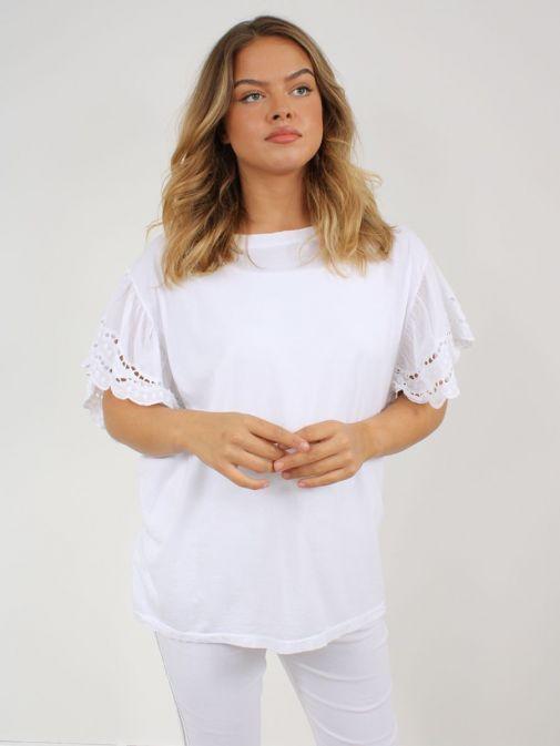Model wearing Cilento Woman Broderie Butterfly Sleeve Top in White
