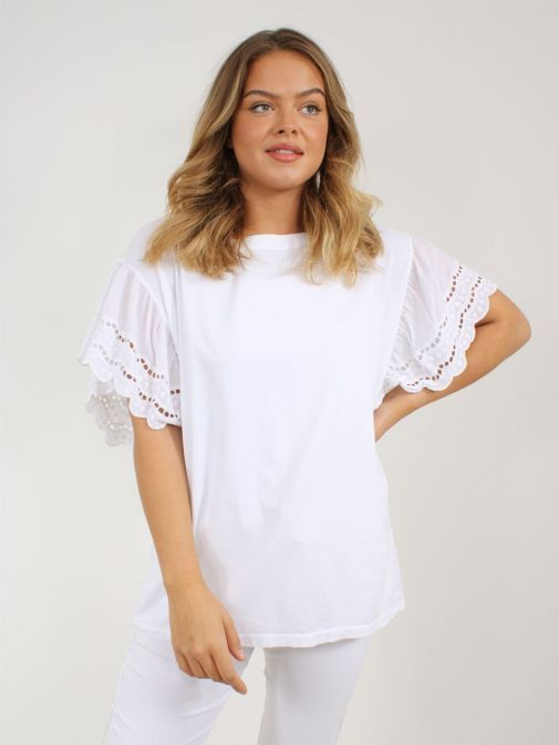 Model wearing Cilento Woman Broderie Butterfly Sleeve Top in White showing off the sleeve