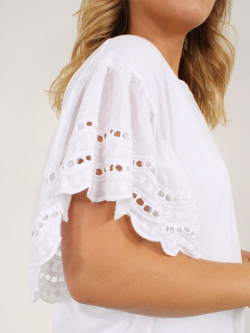 Close up of model wearing Cilento Woman Broderie Butterfly Sleeve Top in White