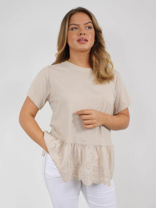 Model wearing Cilento Woman Broderie Frill Hem Top in Beige