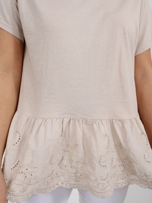 Close up of Cilento Woman Broderie Frill Hem Top in Beige