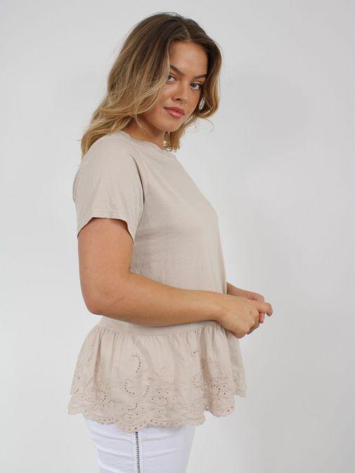 Side shot of Model wearing Cilento Woman Broderie Frill Hem Top in Beige