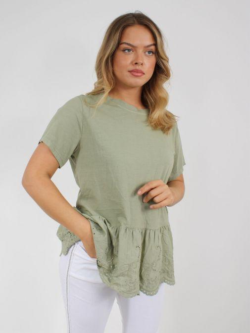 Model wearing Cilento Woman Broderie Frill Hem Top in Green