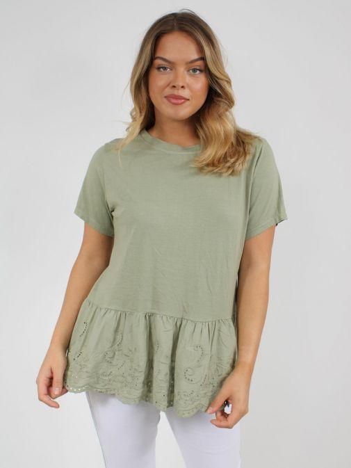 Alternative shot of model wearing Cilento Woman Broderie Frill Hem Top in Green