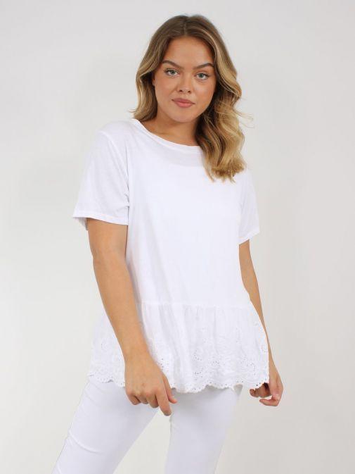Model wearing Cilento Woman Broderie Frill Hem Top in White