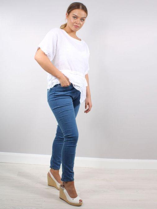 Full shot of model wearing Cilento Woman Denim Joggers in Mid Wash