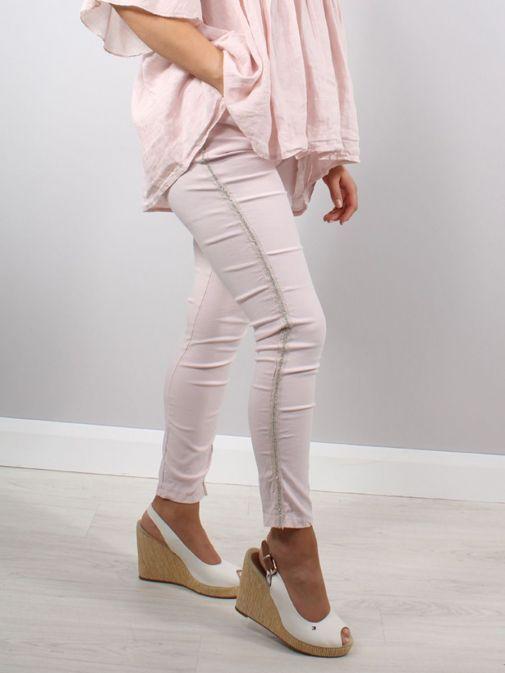 Model wearing Cilento Woman Diamante Denim Joggers in Pink