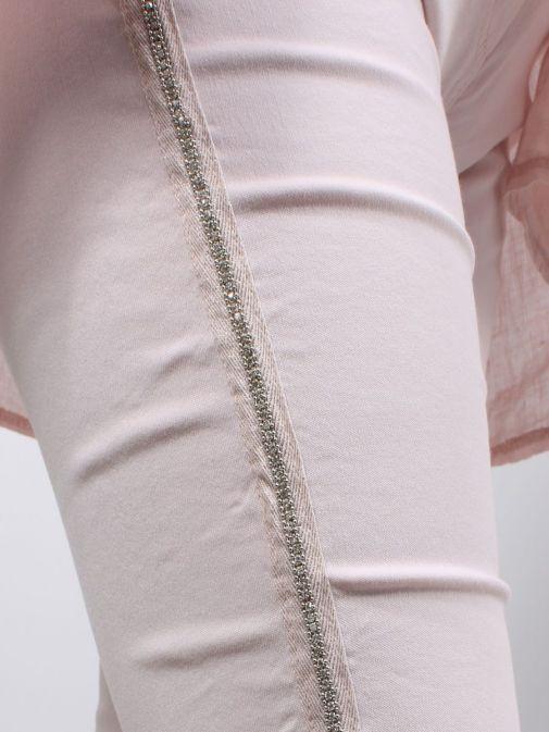 Close up shot of model wearing Cilento Woman Diamante Denim Joggers in Pink