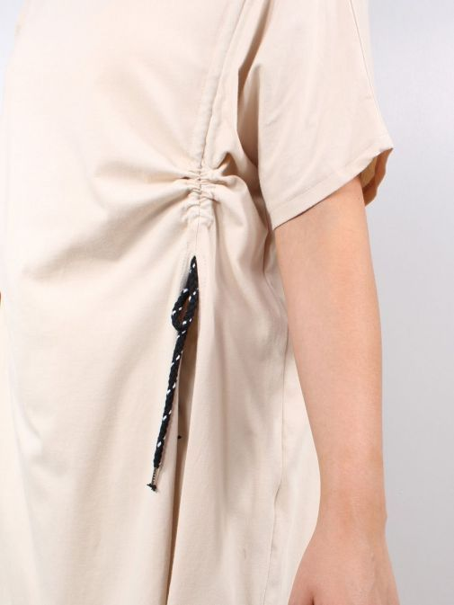 Close up of model wearing Cilento Woman Drawstring Tunic in Beige