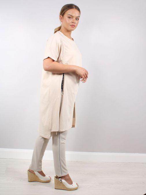 Side shot of model wearing Cilento Woman Drawstring Tunic in Beige