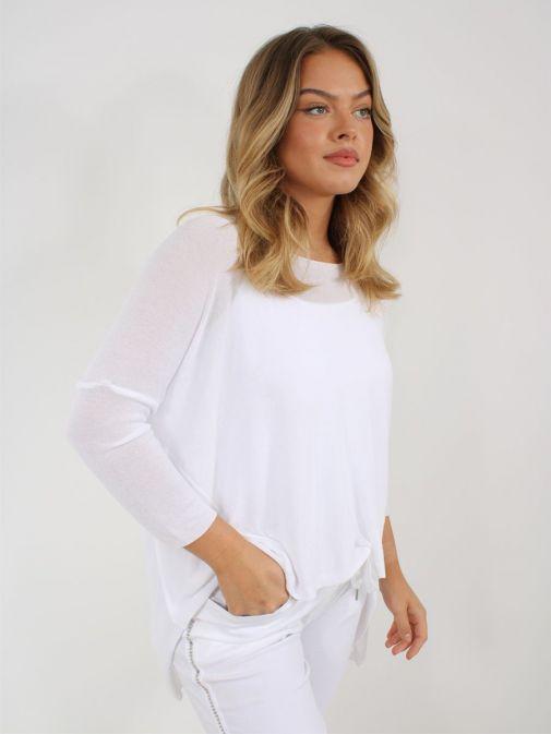 Side shot of Model wearing Cilento Woman Fine Knit Sweater in White
