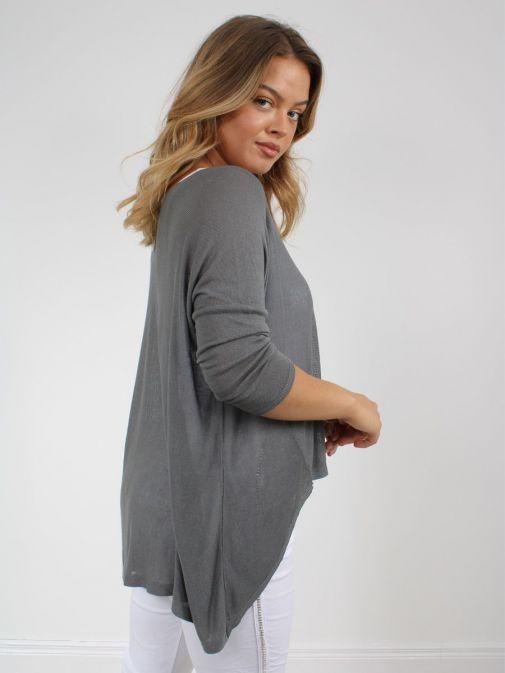 Side shot of model wearing Cilento Woman Fine Knit Sweater in Grey