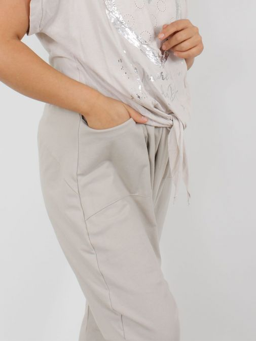 Close up of Model wearing Cilento Woman Harem Joggers in Beige