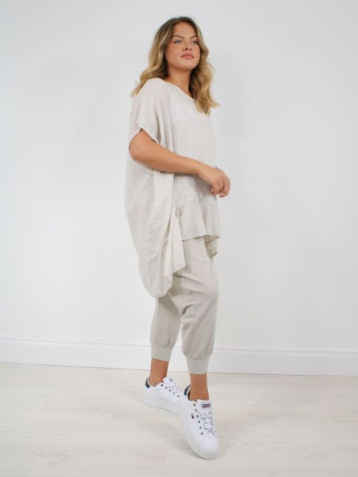 Model wearing Cilento Woman Harem Joggers in Beige paired with beige top