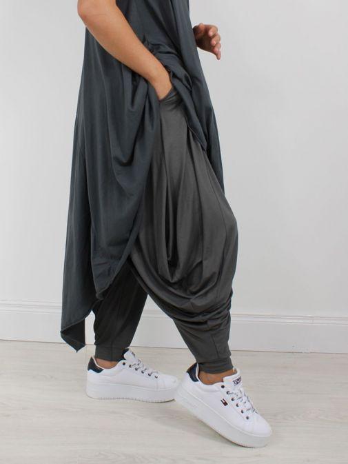 Model wearing Cilento Woman Harem Pants in Grey
