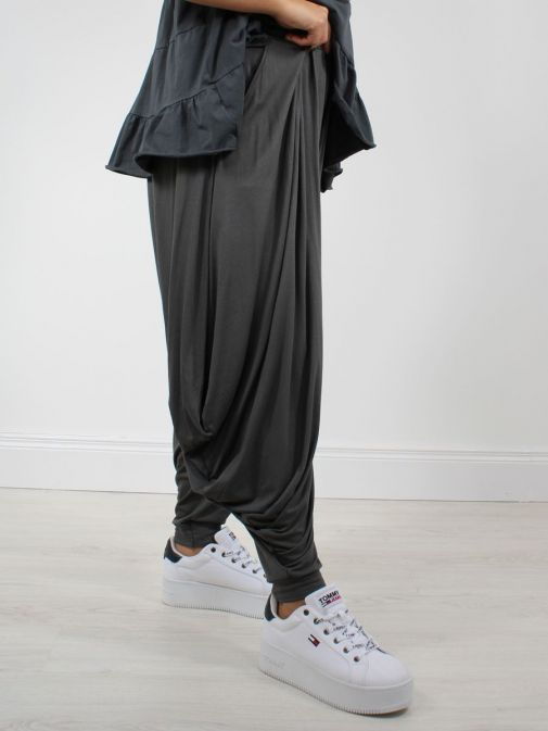 Close up of Model wearing Cilento Woman Harem Pants in Grey