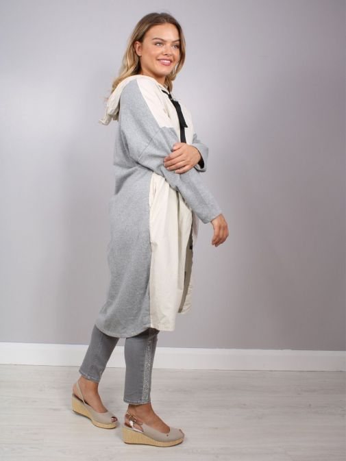 side shot of the Cilento Woman Hooded Longline Jacket in the Cream and Grey featuring black zip, long sleeves and hood