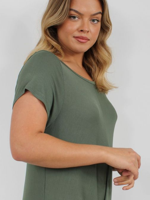 Close up Picture of Model wearing Cilento Woman Jersey Jumpsuit in Green