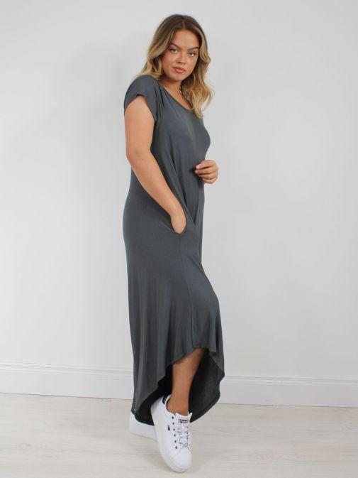 Side shot of model wearing Cilento Woman Jersey Jumpsuit in Grey