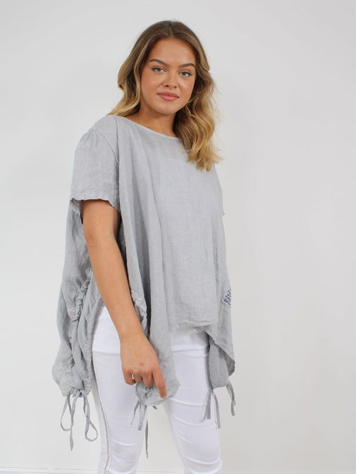 side shot of the Cilento Woman Linen Drawstring Top in the Grey colour featuring short sleeves, rounded neckline, pull cords to each side