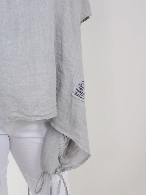 closeup shot of the Cilento Woman Linen Drawstring Top in the Grey colour featuring branded patch