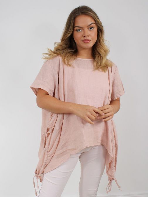 Front shot of the Cilento Woman Linen Drawstring Top in the Peach colour featuring short sleeves, rounded neckline, pull cords to each side