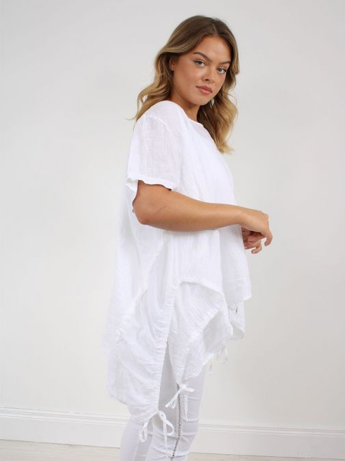 side shot of the Cilento Woman Linen Drawstring Top in the White colour featuring short sleeves, rounded neckline, pull cords to each side