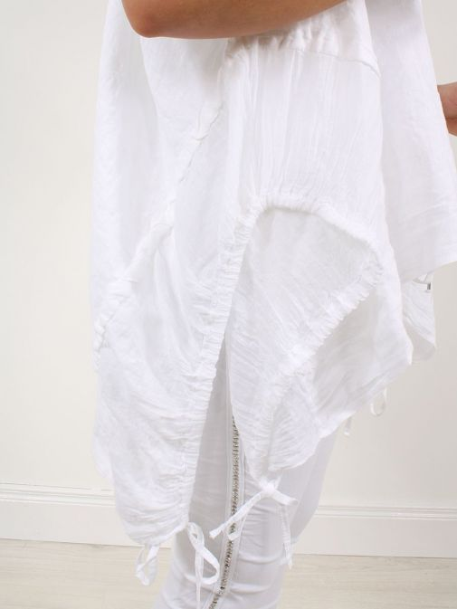 closeup shot of the Cilento Woman Linen Drawstring Top in the White colour featuring  pull cords to each side
