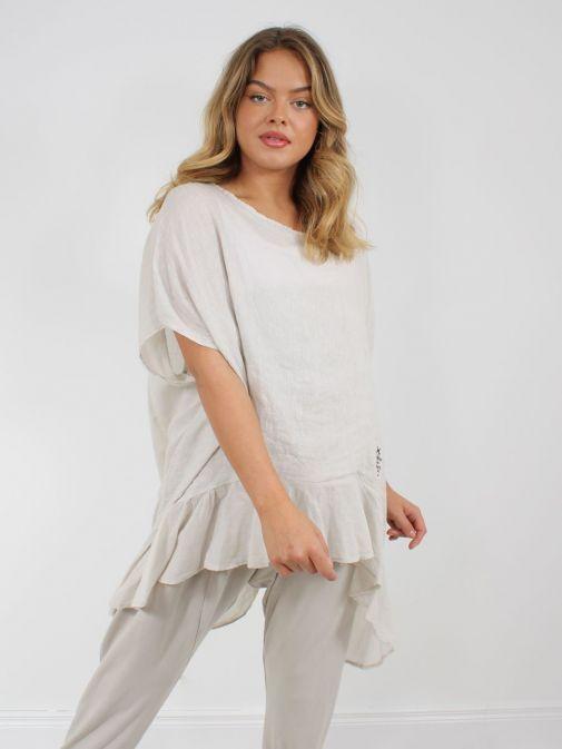 Model wearing Cilento Woman Linen Frill Hem Tunic in Beige