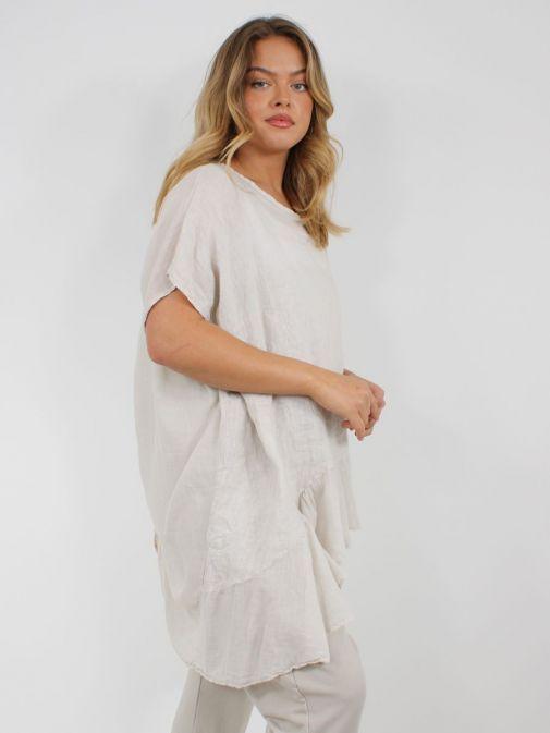 Side shot of model wearing Cilento Woman Linen Frill Hem Tunic in Beige