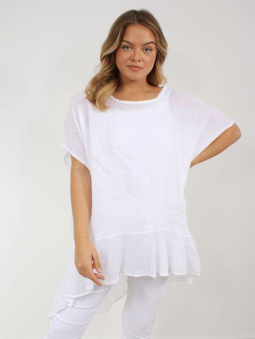 Model wearing Cilento Woman Linen Frill Hem Tunic in White