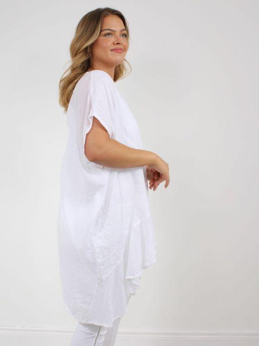 Side shot of model wearing Cilento Woman Linen Frill Hem Tunic in White