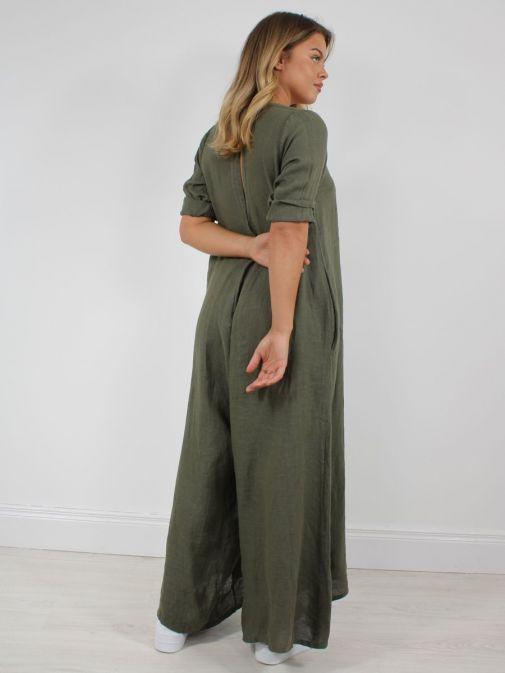 Shot from behind of model wearing Cilento Woman Linen Jumpsuit in Khaki Green