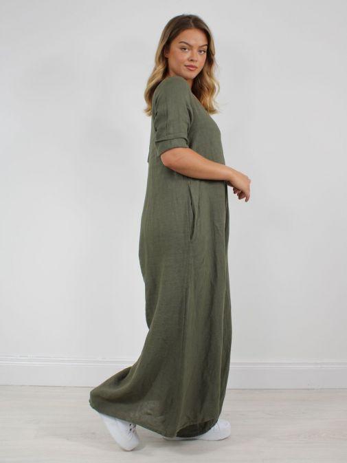 Side shot of Model wearing Cilento Woman Linen Jumpsuit in Khaki Green