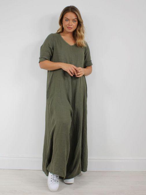 Model wearing Cilento Woman Linen Jumpsuit in Khaki Green