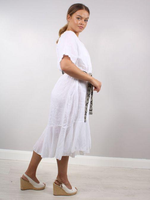 Back shot of Model wearing Cilento Woman Linen Midi Dress in White