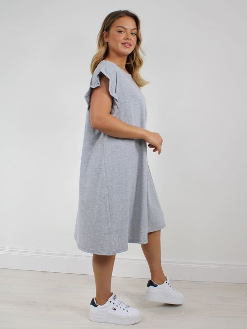 side shot of the Cilento Woman Ruffle Sleeve Dress in the Grey colour featuring ruffle sleeves, rounded neckline, midi length
