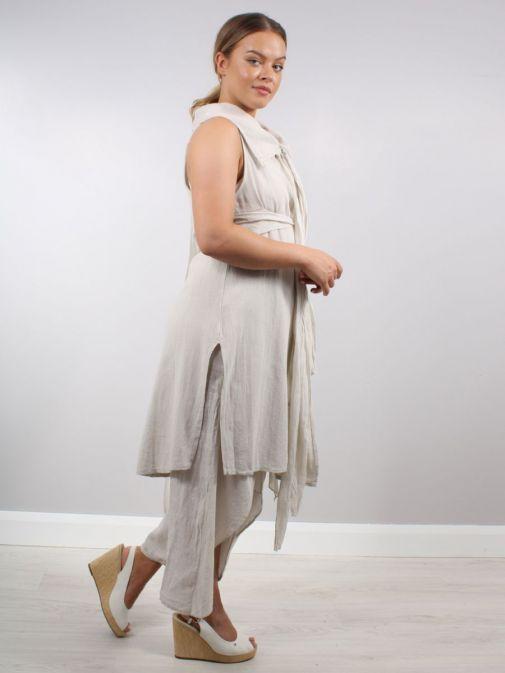 Side shot of model wearing Cilento Woman Tie Detail Tunic in Beige