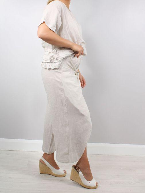 Side shot of Model wearing Cilento Woman Wrap Leg Linen Trousers in Natural