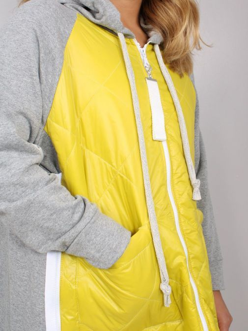 Close up of model wearing Cilento Woman Zip Up Hooded Jacket in Yellow and Grey