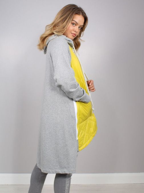 Side shot of model wearing Cilento Woman Zip Up Hooded Jacket in Yellow and Grey
