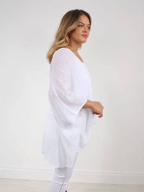 side shot of the Cilento Women Button Top White featuring batwing sleeve, button fastening and round neckline