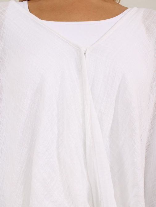 closeup shot of the Cilento Women Button Top White featuring button fastening and round neckline